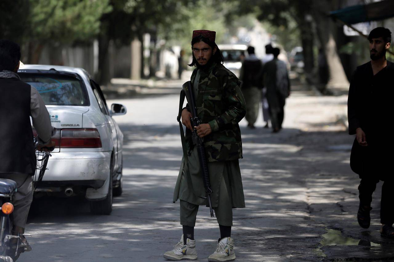 A Taliban fighter stands guard at a checkpoint in the Wazir Akbar Khan neighborhood in the city of Kabul, Afghanistan, Sunday, Aug. 22, 2021. A panicked crush of people trying to enter Kabul's international airport killed several Afghan civilians in the crowds, the British military said Sunday, showing the danger still posed to those trying to flee the Taliban's takeover of the country. (AP Photo/Rahmat Gul)