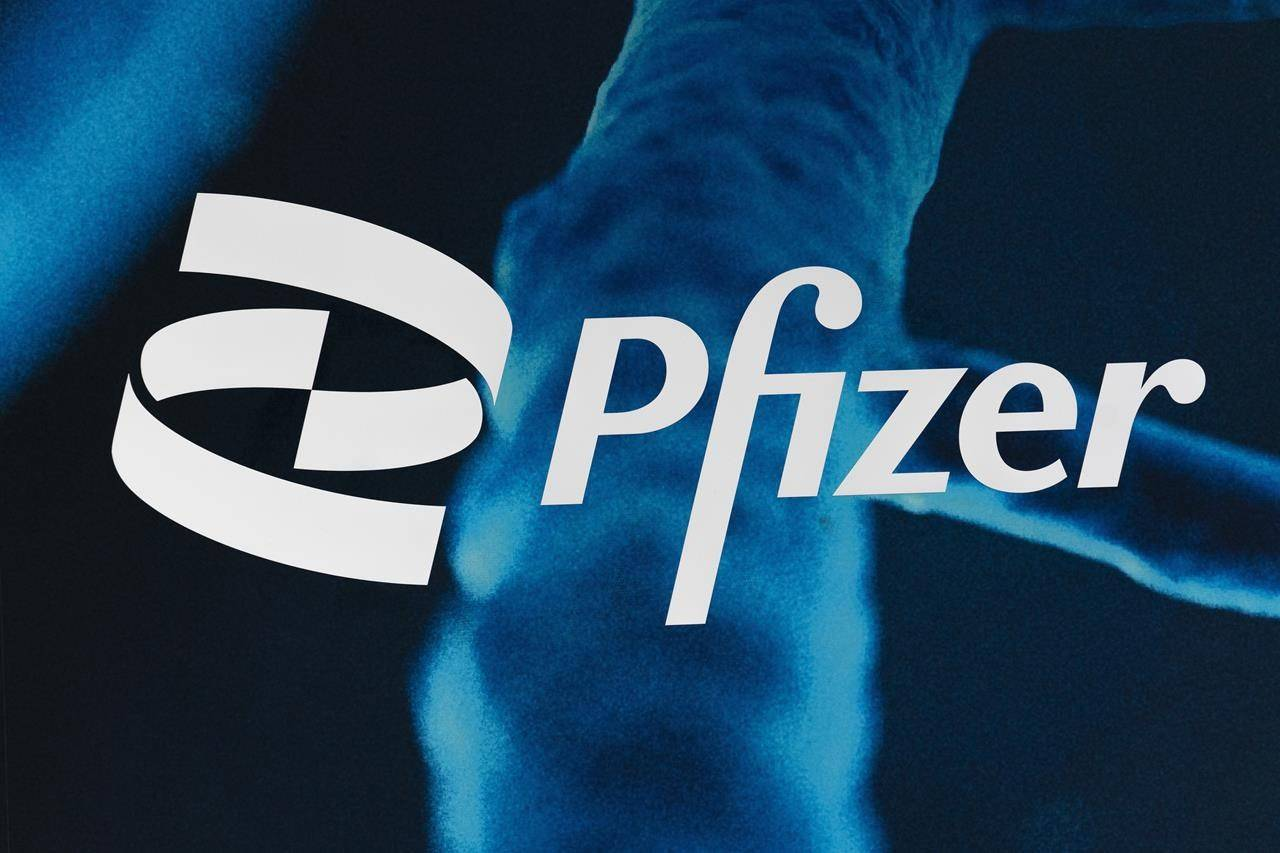 FILE - In this Feb. 5, 2021, file photo, the Pfizer logo is displayed at the company's headquarters in New York. The U.S. gave full approval to Pfizer's COVID-19 vaccine on Monday, Aug. 23, 2021. (AP Photo/Mark Lennihan, File)