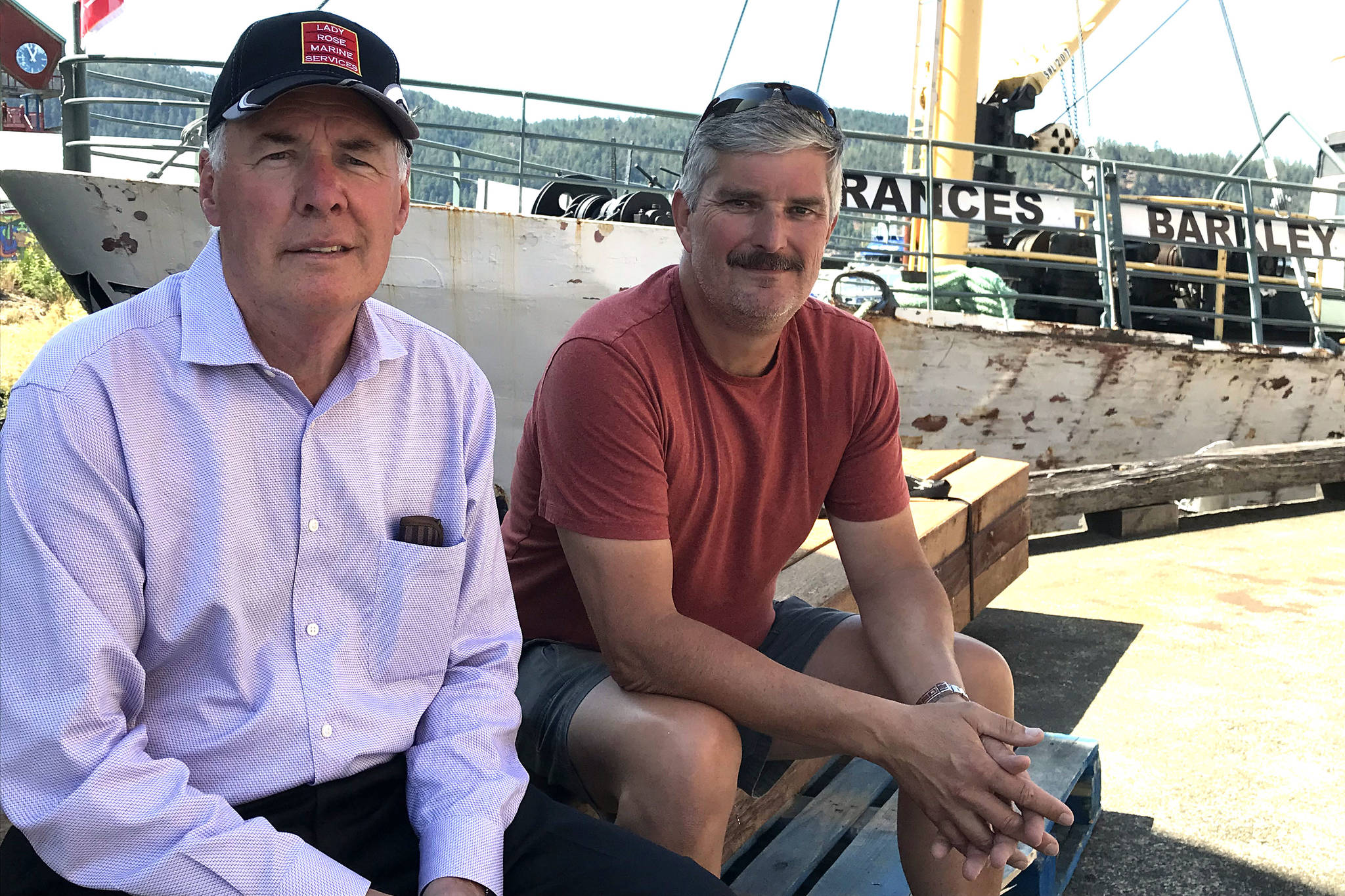 Greg Willmon, left, from Devon Transport Ltd. of Nanaimo meets with Mike Surrell to talk about the transfer of ownership of Lady Rose Marine Services to Willmon and his partner Barrie Rogers. (SUSAN QUINN/ Alberni Valley News)
