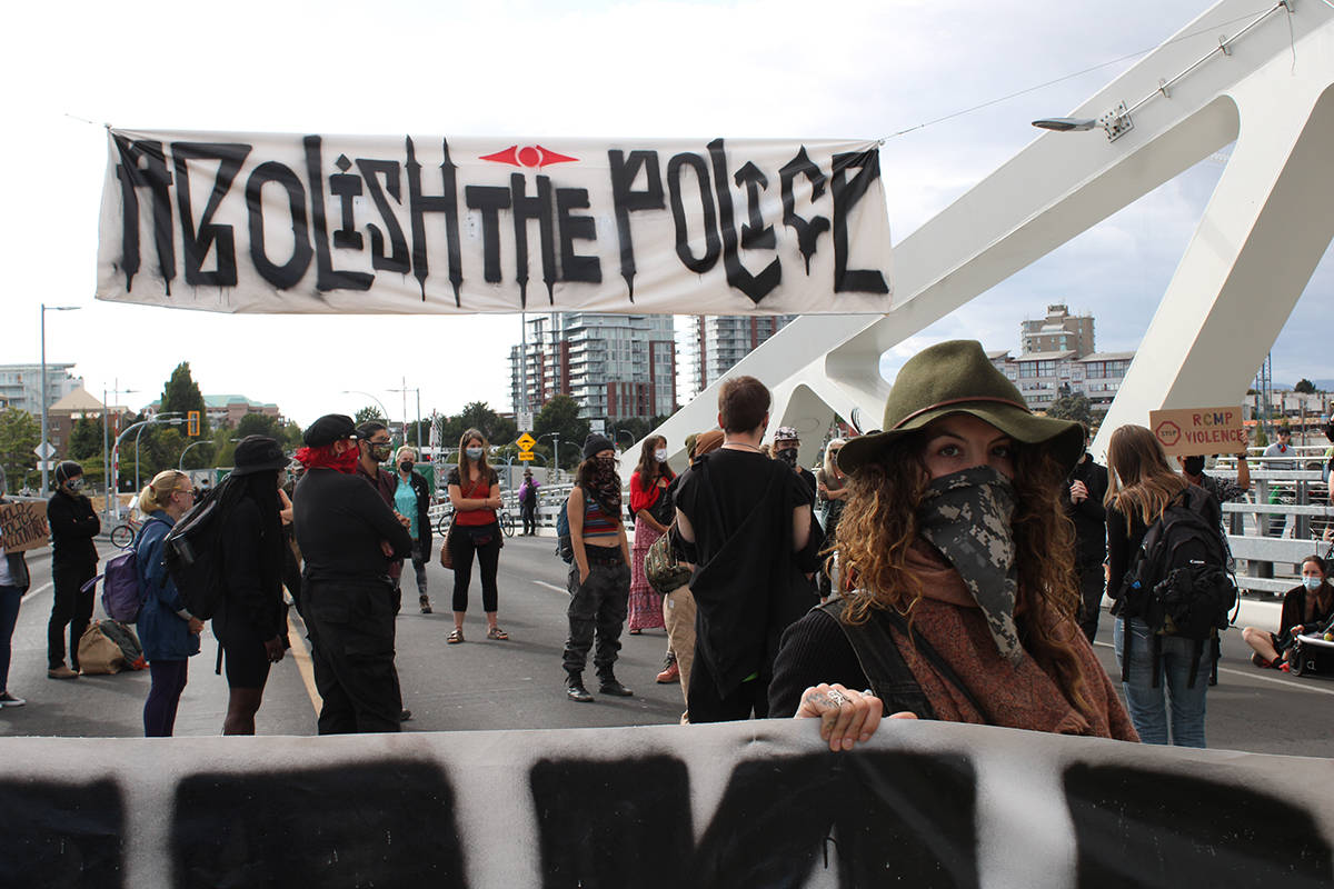 Protesters block the Johnson Street bridge in Victoria ahead of evening commuter time Tuesday. (Jake Romphf/News Staff)