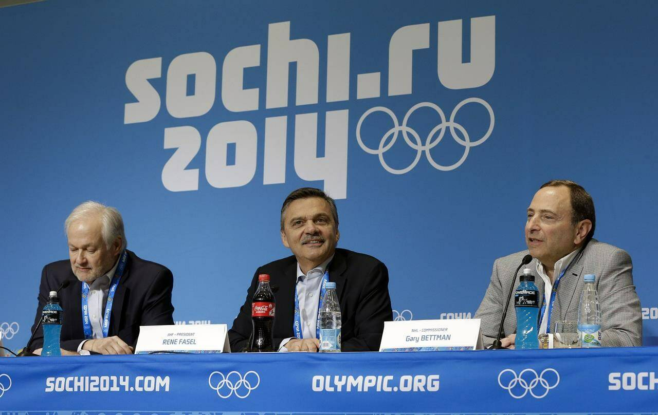 FILE - In this Feb. 18, 2014, file photo, NHL Players' Association Executive Director Don Fehr, left, International Ice Hockey Federation President Rene Fasel, center, and NHL Commissioner Gary Bettman, right, answer questions during a news conference at the 2014 Winter Olympics in Sochi, Russia. (AP Photo/Mark Humphrey, File)