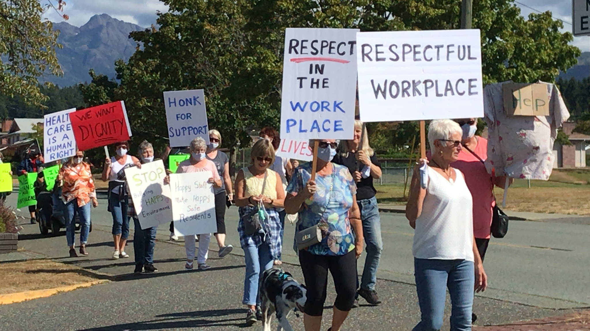 Former healthcare workers, family members and other supporters march from the parking lot at Echo Centre to the front of Echo Village long-term care home in Port Alberni on Tuesday, Aug. 31, 2021. (SUSAN QUINN/ Alberni Valley News)