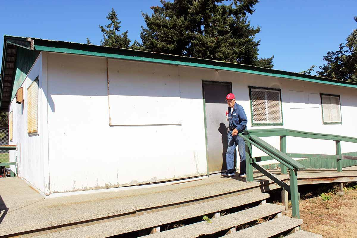 Chemainus & District Baseball Association president Larry Hopwo exits the clubhouse building he managed to secure for the association from his former employer when he worked for MacMillan Bloedel. (Photo by Don Bodger)