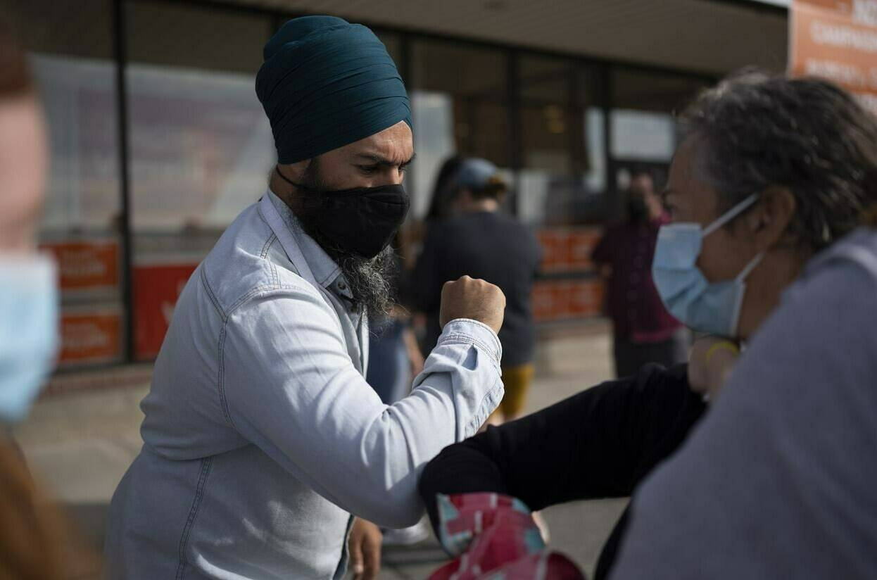 NDP leader Jagmeet Singh greets supporters outside a campaign office in Sudbury, Ont., Sunday, September 12, 2021. THE CANADIAN PRESS/Jonathan Hayward