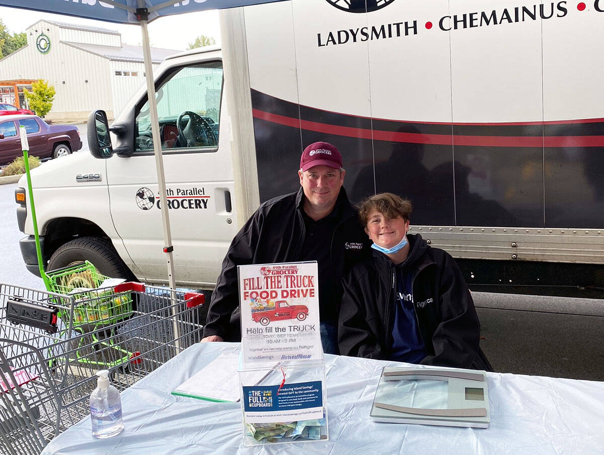 Chemainus 49th Parallel Grocery store manager Paul McGregor and son Isaac at the Fill the Truck event. (Photo submitted)