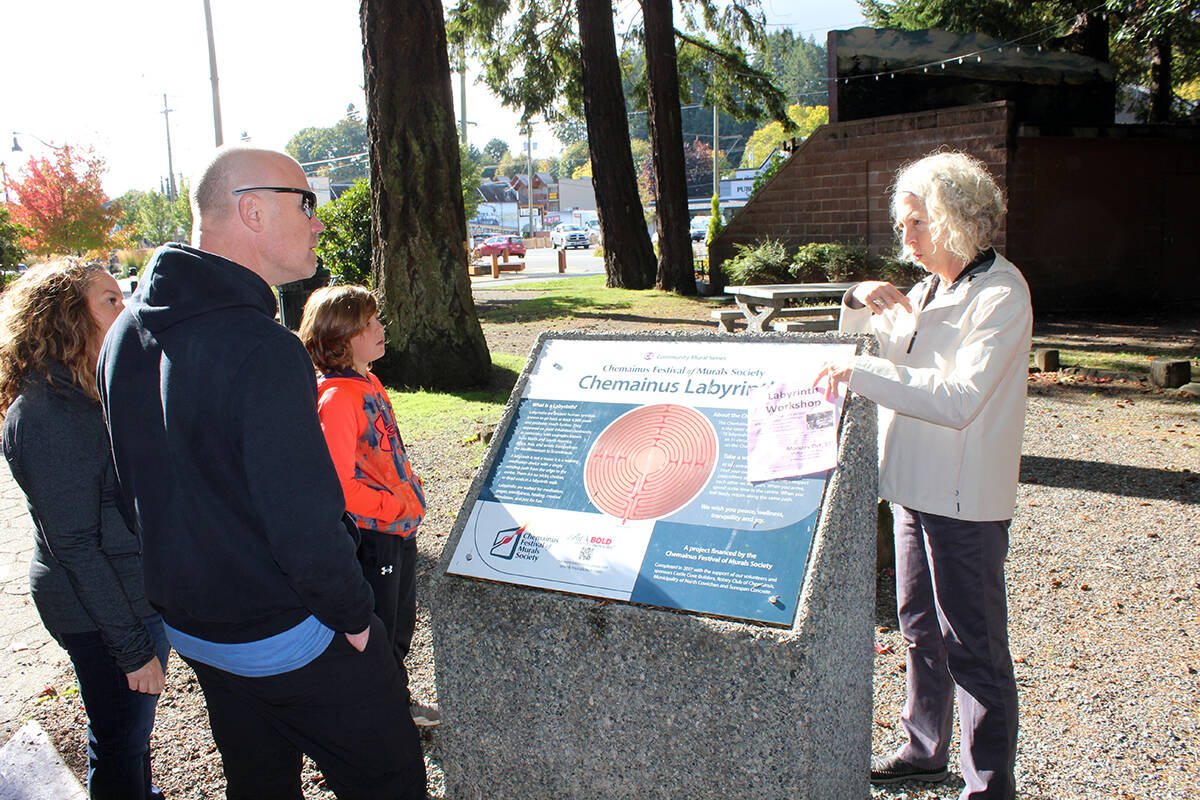 Elise Feltrin talks to some interested persons about the Chemainus Labyrinth. (Photo by Don Bodger)