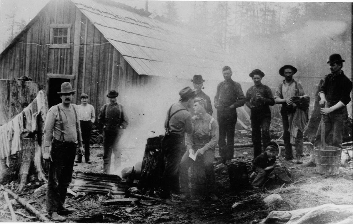 CAMPing out That meant something quite different in the old days. This photo is from Wash Day at a logging camp, exact date and location unknown. (Photo courtesy Chemainus Valley Museum)