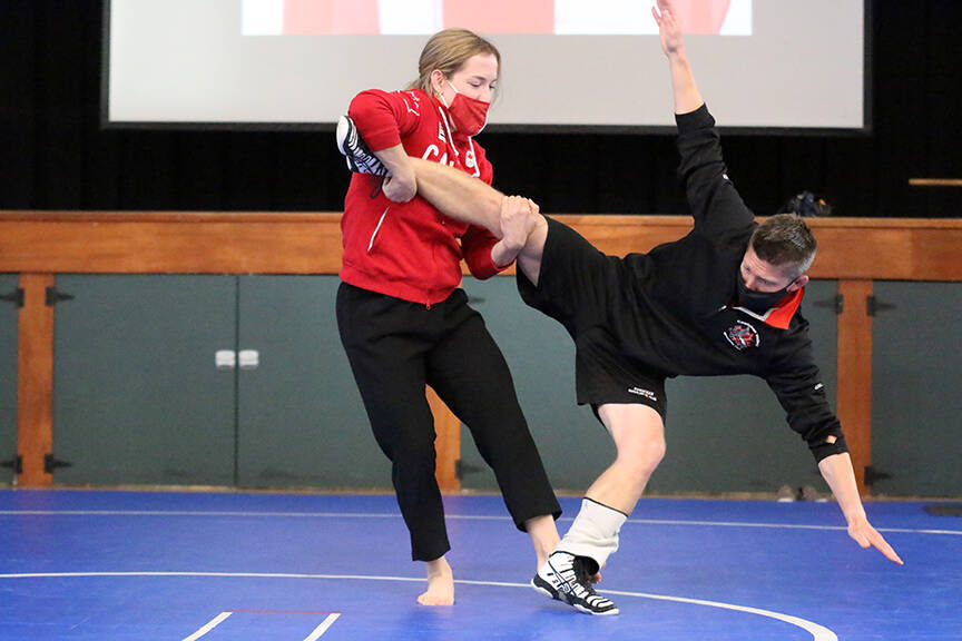 Two-time Olympic wrestler Danielle Lappage shows off some moves, using Cowichan Valley Wrestling Club as her guinea pig, after speaking to students at Queen Margaret's School on Oct. 8. (Kevin Rothbauer/Citizen)